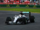 MELBOURNE, AUSTRALIA - MARCH 18: Lewis Hamilton of Great Britain drives the (44) Mercedes AMG Petronas F1 Team Mercedes F1 WO7 Mercedes PU106C Hybrid turbo on track during practice ahead of the Australian Formula One Grand Prix at Albert Park on March 18, 2016 in Melbourne, Australia.  (Photo by Robert Cianflone/Getty Images)