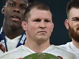 England's captain and hooker Dylan Hartley (C) poses with the Triple Crown trophy following the Six Nations international rugby union match between England and Wales at Twickenham in south west London on March 12, 2016.   / AFP / BEN STANSALL        (Photo credit should read BEN STANSALL/AFP/Getty Images)
