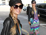 Los Angeles, CA - Paris Hilton looks groovy in a bright psychedelic dress at LAX as she departs for Miami. The Hilton heiress looks ready for spring in her bright and colorful ensemble. \nAKM-GSI     March 18, 2016\nTo License These Photos, Please Contact :\nSteve Ginsburg\n(310) 505-8447\n(323) 423-9397\nsteve@akmgsi.com\nsales@akmgsi.com\nor\nMaria Buda\n(917) 242-1505\nmbuda@akmgsi.com\nginsburgspalyinc@gmail.com