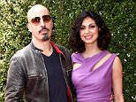LOS ANGELES, CA - APRIL 13:  Actress Morena Baccarin (R) and director Austin Chick attend the 11th annual John Varvatos Stuart House Benefit held at the John Varvatos on April 13, 2014 in Los Angeles, California.  (Photo by Tommaso Boddi/WireImage)