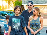 18.MAR.2016 - Calabasas - USA *** STRICTLY AVAILABLE FOR UK AND GERMANY USE ONLY *** ** EXCLUSIVE ALL ROUND PICTURES ** LeAnn Rimes arrives for dinner at The Six Restaurant in Calabasas with Eddie Cibrian and his two boys Mason and Jake, while wearing a Grateful Dead tee shirt that showed off her side boob BYLINE MUST READ : AKM-GSI-XPOSURE ***UK CLIENTS - PICTURES CONTAINING CHILDREN PLEASE PIXELATE FACE PRIOR TO PUBLICATION *** *UK CLIENTS MUST CALL PRIOR TO TV OR ONLINE USAGE PLEASE TELEPHONE 0208 344 2007*