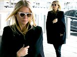 *EXCLUSIVE* New York, NY - Oscar-winner actress Gwyneth Paltrow bundles up ahead of a departing flight from JFK Airport. Gwyneth, who 'consciously uncoupled' from estranged husband, Coldplay singer Chris Martin last year, is currently dating Scream Queens producer Brad Falchuk. The actress has been busy promoting her new line of GOOP organic skincare products, and revealed she is retiring from acting to focus on growing the lifestyle company.\nAKM-GSI      March 20, 2016\nTo License These Photos, Please Contact :\nSteve Ginsburg\n(310) 505-8447\n(323) 423-9397\nsteve@akmgsi.com\nsales@akmgsi.com\nor\nMaria Buda\n(917) 242-1505\nmbuda@akmgsi.com\nginsburgspalyinc@gmail.com