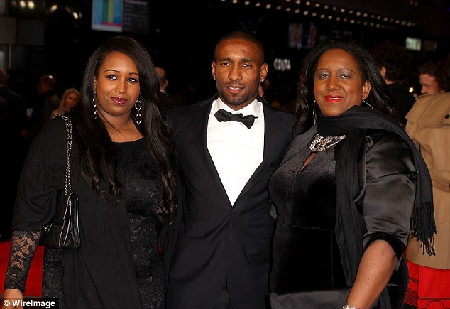 Sunderland striker Defoe, pictured with Sandra and sister Chonte (left), has a close relationship with his mum