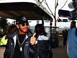 MELBOURNE, AUSTRALIA - MARCH 19: Lewis Hamilton of Great Britain and Mercedes GP arrives at the circuit during qualifying for the Australian Formula One Grand Prix at Albert Park on March 19, 2016 in Melbourne, Australia.  (Photo by Robert Cianflone/Getty Images)