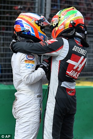 The Formula One pair embrace in a hug on Sunday