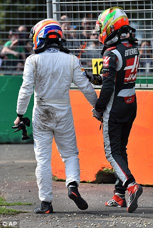 They leave the track to receive medical treatment following their dramatic collision