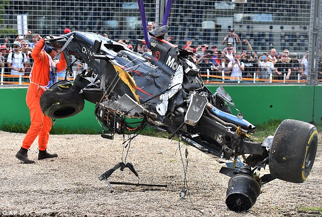 His car was removed from the gravel with the help of a track official and the race was briefly brought to a halt
