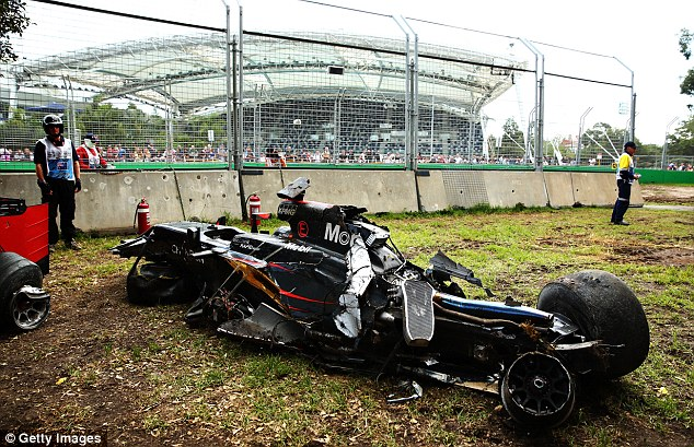 The wreckage of Alonso's McLaren car by the side of the track following the collision during Sunday's race