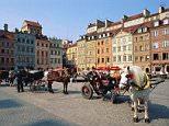 Warsaw, Poland......Horsedrawn carriages in square,  Image: © Svenja-Foto/zefa/Corbis