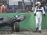 McLaren driver Fernando Alonso of Spain looks back at his wrecked car after he collided with Haas driver Esteban Gutierrez of Mexico during the Australian Formula One Grand Prix at Albert Park in Melbourne, Australia, Sunday, March 20, 2016. (AP Photo/Theo Karanikos)