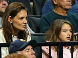 20 March 2016: Katie Holmes and daughter Suri Cruise during the Notre Dame Fighting Irish game versus the Stephen F Austin Lumberjacks in the second round of the Division I Men's Championship at Barclays Center in Brooklyn, NJ. (Photo by Rich Graessle/Icon Sportswire) (Icon Sportswire via AP Images)