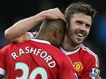 Manchester United's Marcus Rashford celebrates with Michael Carrick at the end of the Barclays Premier League match between Manchester City and Manchester United played at the Etihad Stadium, Manchester on March 20th 2016