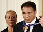 George W. Bush, US President, awards boxing legend Muhammad Ali with the Presidential Medal of Freedom as Ali's wife Lonnie watches during a ceremony in the East Room of the White House in Washington. President Bush presented the award to fourteen honourees.