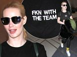 "Los Angeles, CA - Iggy Azalea departs LAX solo but claims she is ""FKN WITH THE TEAM"" via her black t-shirt. The stylish singer also wore plaid flannel around her waist with black leggings, gold socks, and platform sneakers. \nAKM-GSI        March 21, 2016\nTo License These Photos, Please Contact :\nSteve Ginsburg\n(310) 505-8447\n(323) 423-9397\nsteve@akmgsi.com\nsales@akmgsi.com\nor\nMaria Buda\n(917) 242-1505\nmbuda@akmgsi.com\nginsburgspalyinc@gmail.com"