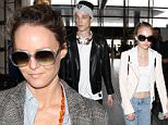 Vanessa Paradis heads through LAX on route to a flight for Paris. The model and singer is joined by her two children, whom she shares with Johnny Depp, Lily-Rose and John. Lily-Rose, a model in the making, is accompanied by a mystery man. Monday, March 21, 2016 X17online.com
