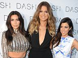 MIAMI BEACH, FL - MARCH 12: Kim Kardashian, Khloe Kardashian and Kourtney Kardashian attend the Grand Opening of DASH Miami Beach at Dash Miami Beach on March 12, 2014 in Miami Beach, Florida. (Photo by Larry Marano/WireImage)