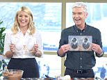 EDITORIAL USE ONLY. NO MERCHANDISING Mandatory Credit: Photo by Ken McKay/ITV/REX/Shutterstock (5618385af) Paul A Young with Holly Willoughby and Phillip Schofield 'This Morning' TV show, London, Britain - 23 Mar 2016 MAKE YOUR OWN EASTER EGG, The Easter weekend is upon us which means the prospect of lots of delicious chocolate eggs. Here to show us how to bring a touch of nostalgia into the house this Easter is Paul A Young, with his guide to making Easter eggs filled with all your favourite sweets.