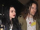 Frances Bean Cobain and her fiancé Isaiah Silva make their way through LAX