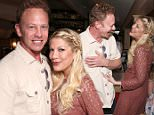 """WEST HOLLYWOOD, CA - MARCH 23:  Tori Spelling and Ian Ziering attend Twentieth Century Fox Home Entertainments' """"Alvin And The Chipmunks: The Road Chip"""" Blu-ray Release Party at Au Fudge on March 23, 2016 in West Hollywood, California.  (Photo by Todd Williamson/Getty Images for Twentieth Century Fox Home Entertainment)"""