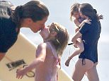 03/21/2016\nPREMIUM EXCLUSIVE: Gisele B?ndchen continues her third day of a surfing vacation with husband Tom Brady as they hit the beach in Costa Rica. Gisele first took the time for a private lesson with a surf coach where she allowed her daughter to come down to the beach and watch. After the lesson the 35 year old mother of two took to the ocean with board in hand, later joined by husband Tom Brady. The mother of two wrapped up the day by greeting her adorable daughter on the beach where she leaned in and gave the young girl a kiss.  \nPlease byline:TheImageDirect.com\n*EXCLUSIVE PLEASE EMAIL sales@theimagedirect.com FOR FEES BEFORE USE\n