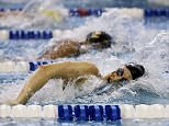 Georgia's Meaghan Raab, bottom, swims against Southern California's Chelsea Chenault, top, in the 800-yard freestyle relay at the NCAA women's swimming and diving championships at Georgia Tech Wednesday, March 16, 2016, in Atlanta. (AP Photo/David Goldman)