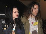 UK CLIENTS MUST CREDIT: AKM-GSI ONLY..Frances Bean Cobain and her fiancé Isaiah Silva make their way through LAX after their return home from the Sundance Film Festival.  The 22-year-old daughter of Kurt Cobain reunited with her mom Courtney Love, for the first time in five years, at the premiere of 'Kurt Cobain: Montage of Heck'.....Pictured: Frances Bean Cobain, Isaiah Silva..Ref: SPL936907  260115  ..Picture by: AKM-GSI / Splash News....