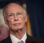 Alabama Gov. Robert Bentley stands during a news conference Wednesday, March 23, 2016, at the state Capitol in Montgomery, Ala. Bentley admitted Wednesday he made inappropriate remarks to a top female staffer two years ago, but he denied accusations that he had a physical affair. (Albert Cesare/The Montgomery Advertiser via AP)  NO SALES; MANDATORY CREDIT