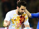 """Spain's midfilder Frances Fabregas Soler (L) fights for the ball with Italy's defender Matteo Darmian during the friendly football match between Italy and Spain at """"Friuli-Dacia Arena"""" Stadium in Udine on March 24, 2016. / AFP PHOTO / GIUSEPPE CACACEGIUSEPPE CACACE/AFP/Getty Images"""