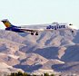 LAS VEGAS - SEPTEMBER 6:  An Allegiant Air jet carrying members of the New Orleans Fire Department comes in for a landing at McCarran International Airport on September 6, 2005 in Las Vegas, Nevada. The Las Vegas-based airline will initially pick up the cost of flying New Orleans police, firefighters and their families to Vegas for a three to five day vacation at local hotel-casinos to provide rest to those traumatized by the damage inflicted by Hurricane Katrina.  (Photo by Ethan Miller/Getty Images)