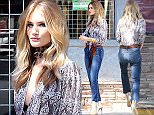 Rosie Huntington-Whiteley is seen with her engagement ring OFF while she is hard at work, doing a photoshoot for Paige Denim at the legendary Troubadour nightclub on the Sunset Strip in West Hollywood, CA. Whiteley is sexy in a paisley blouse, blue jeans with an animal print scarf and gold heels. Wednesday, March 23, 2016.X17online.com\nNO WEB SITE USAGE\nMAGAZINES NORMAL FEES\nAny queries please call Lynne or Gary on office 0034 966 713 949 \nGary mobile 0034 686 421 720 \nLynne mobile 0034 611 100 011\n