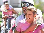 *PREMIUM EXCLUSIVE* **MUST CALL FOR PRICING** Savannah, GA - Zac Efron and Dwayne Johnson have a busy but fun morning on the set of their next movie 'Baywatch' while filming a scene on top of a pink scooter wearing matching tees and funny helmets!\nCREDIT MUST READ: FameFlynet/AKM-GSI\nAKM-GSI      March 21, 2016\nTo License These Photos, Please Contact :\nSteve Ginsburg\n(310) 505-8447\n(323) 423-9397\nsteve@akmgsi.com\nsales@akmgsi.com\nor\nMaria Buda\n(917) 242-1505\nmbuda@akmgsi.com\nginsburgspalyinc@gmail.com