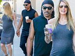 Picture Shows: Paige Butcher, Eddie Murphy  March 24, 2016\n \n Comedian Eddie Murphy and his pregnant girlfriend Paige Butcher stop by Coffee Bean in Studio City, California. Paige wore a grey dress that accentuated her baby bump.\n \n Non-Exclusive\n UK RIGHTS ONLY\n \n Pictures by : FameFlynet UK © 2016\n Tel : +44 (0)20 3551 5049\n Email : info@fameflynet.uk.com