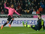 Ikechi Anya of Scotland (L) scores past Czech goalkeeper Tomas Koubek during the friendly football match between the Czech Republic and Scotland at the Arena in Prague, on March 24, 2016.  / AFP PHOTO / Michal CizekMICHAL CIZEK/AFP/Getty Images