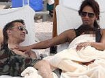 Exclusive... 52003193 Former couple Halle Berry and Olivier Martinez enjoy a day on the beach with their son Maceo and her daughter Nahla in Mexico on March 22, 2016. Despite the pair going through a bitter divorce they have become good friends for the sake of their son and are spending as much time together as they can. Halle and Maceo relaxed on sun chairs while Olivier took Nahla boogie boarding in the ocean surf. At one point Halle could be seen with her hand on Olivier's chest. FameFlynet, Inc - Beverly Hills, CA, USA - +1 (310) 505-9876