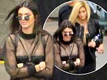 Please contact X17 before any use of these exclusive photos - x17@x17agency.com   Kendall Jenner wears a sexy sheer top as she leaves Justin Bieber's concert with blonde-haired sister Kylie. The concert was held at Staples Center in downtown Los Angeles. March 23, 2016 X17online.com PREMIUM EXCLUSIVE