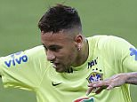 Brazil's Neymar practices during a training session in Recife, Brazil, Thursday, March 24, 2016.  Brazil will face Uruguay in a 2018 World Cup qualifying soccer match on Friday. (AP Photo/Andre Penner)