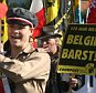 Members of the Flemish nationalist group Voorpost (Outpost) carrying a symbolic coffin of Belgium during a demonstration for independence for the Flemish part of Belgium in Rhode-Saint-Genest, near Brussels, 07 October 2007. Tensions have been rising since the general elections more than three months ago, with Belgium's two largest communities Flanders and Wallonia unable to overcome their differences and form a government.                AFP PHOTO/DOMINIQUE FAGET (Photo credit should read DOMINIQUE FAGET/AFP/Getty Images)      FAO Amy Marley and Dan Sanderson