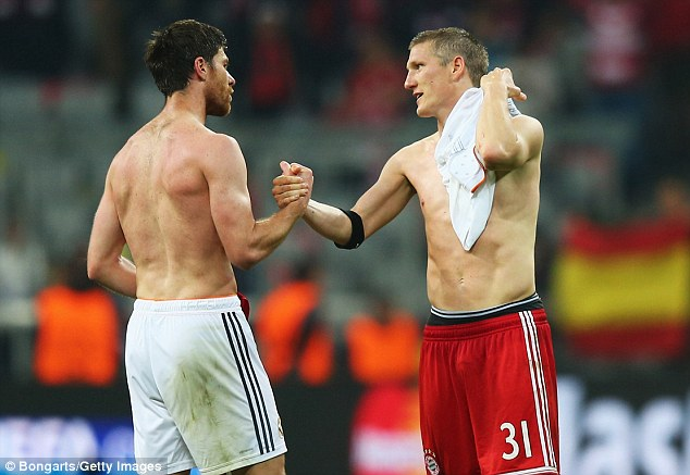 New team-mates: Alonso could line up alongside Bastian Schweinsteiger in the heart of Bayern's midfield