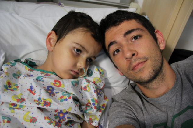 A picture of Ashya with older brother Naveed, who made a heart-rending video for him after the operation