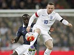 France's defender Bacary Sagna (L) vies against England's striker Wayne Rooney during the friendly football match between England and France at Wembley Stadium in west London on November 17, 2015.    AFP PHOTO / IAN KINGTON\n\nNOT FOR MARKETING OR ADVERTISING USE / RESTRICTED TO EDITORIAL USE        (Photo credit should read IAN KINGTON/AFP/Getty Images)