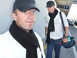 """Los Angeles, CA - Chris Martin catches a flight out of Los Angeles after he finally finalized his divorce from Gwyneth Paltrow. They both signed divorce papers two years after the announcement of their """"conscious uncoupling"""".\nAKM-GSI         March 24, 2016\nTo License These Photos, Please Contact :\nSteve Ginsburg\n(310) 505-8447\n(323) 423-9397\nsteve@akmgsi.com\nsales@akmgsi.com\nor\nMaria Buda\n(917) 242-1505\nmbuda@akmgsi.com\nginsburgspalyinc@gmail.com"""