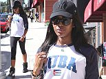 """24.MAR.2016 - HOLLYWOOD - USA *** STRICTLY AVAILABLE FOR UK AND GERMANY USE ONLY *** ** EXCLUSIVE ALL ROUND PICTURES ** Naomi Campbell spends time on Bedford Dr. in the 90210 on Thursday. The 45-year-old model is wearing cropped leggings and a """"Cuba"""" tee paired with Nike sneakers. Barack Obama just made a historic trip to Cuba being the first president to visit Cuba in 8 decades BYLINE MUST READ : AKM-GSI-XPOSURE ***UK CLIENTS - PICTURES CONTAINING CHILDREN PLEASE PIXELATE FACE PRIOR TO PUBLICATION *** *UK CLIENTS MUST CALL PRIOR TO TV OR ONLINE USAGE PLEASE TELEPHONE 0208 344 2007*"""