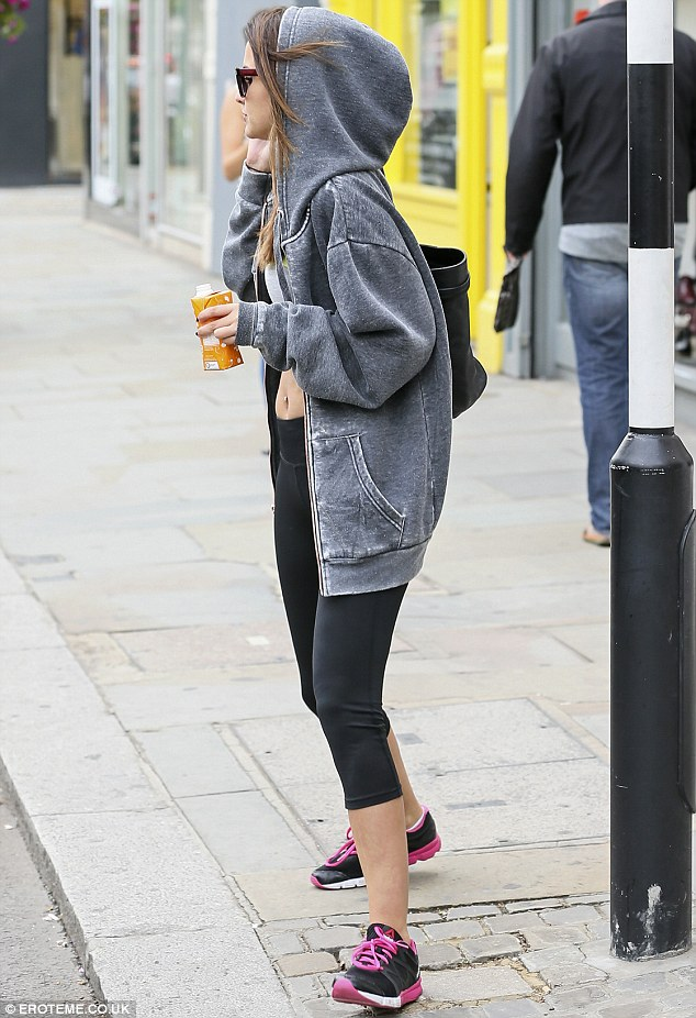 Shady lady: The star carried a large black handbag for all her work-out gear inside