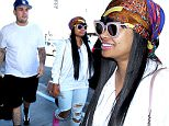 Los Angeles, CA - Rob Kardashian and Blac Chyna match in white shirts while departing LAX. Rob keeps his outfit simple with black athletic shorts and Jordans, while Blac added colors to her with bright pink boots, a bright and colorful head scarf, and a pink Chanel purse. The couple look happy together as they enter the airport. \nAKM-GSI       March 25, 2016\nTo License These Photos, Please Contact :\nSteve Ginsburg\n(310) 505-8447\n(323) 423-9397\nsteve@akmgsi.com\nsales@akmgsi.com\nor\nMaria Buda\n(917) 242-1505\nmbuda@akmgsi.com\nginsburgspalyinc@gmail.com