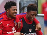 BURTON-UPON-TRENT, ENGLAND - MARCH 24:  (L-R) Rolando Aarons , Chuba Akpom, Demarai Gray and Jordon Ibe joke during an England U21 training session ahead of their UEFA U21 European Championship qualifier against Switzerland at St Georges Park on March 24, 2016 in Burton-upon-Trent, England.  (Photo by Shaun Botterill/Getty Images)