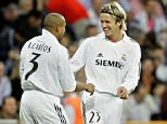 Real Madrid's Brazilian player Roberto Carlos, left, is congratulated by English teammate David Beckham after scoring against Mallorca during their Spanish League soccer match at the Bernabeu stadium in Madrid, Sunday, Oct. 2, 2005. (AP Photo/Bernat Armangue)
