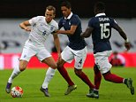 WEMBLEY, ENGLAND - NOVEMBER 17:  Harry Kane of England battles with Raphael Varane and Bacary Sagna of France during the international friendly between England and France at Wembley Stadium on November 17, 2015 in London, England.  (Photo by Catherine Ivill - AMA/Getty Images)
