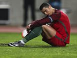 epa05231197 Portugal's Cristiano Ronaldo (L) reacts after missing a penalty kick during their international friendly soccer match at Dr Magalhaes Pessoa Stadium in Leiria, Portugal, 25 March 2016.  EPA/JOSE SENA GOULAO