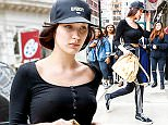 New York, NY - Bella Hadid  is looking casually sexy with her baseball hat and workout pants contrasted by her nice leather Gucci purse on a visit to her sister's apartment in New York City. AKM-GSI          March 25, 2016 To License These Photos, Please Contact : Steve Ginsburg (310) 505-8447 (323) 423-9397 steve@akmgsi.com sales@akmgsi.com or Maria Buda (917) 242-1505 mbuda@akmgsi.com ginsburgspalyinc@gmail.com