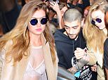 Zayn Malik and GF Gigi Hadid were spotted leaving her NYC Apartment on Friday afternoon. They headed to his live performance at Iheart Radio. They were swarmed by almost 100 fans as they left the Soho building. He protected her with his arm, as they walked through the crowd. She looked stunning in a almost completely sheer white top, and cream duster coat.\n\nPictured: Zayn Malik, Gigi Hadid\nRef: SPL1252553  250316  \nPicture by: 247PAPS.TV / Splash News\n\nSplash News and Pictures\nLos Angeles: 310-821-2666\nNew York: 212-619-2666\nLondon: 870-934-2666\nphotodesk@splashnews.com\n